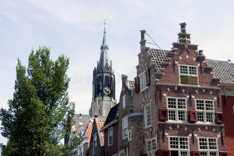 Church and houses in Delft. With typical Dutch gables stock photos