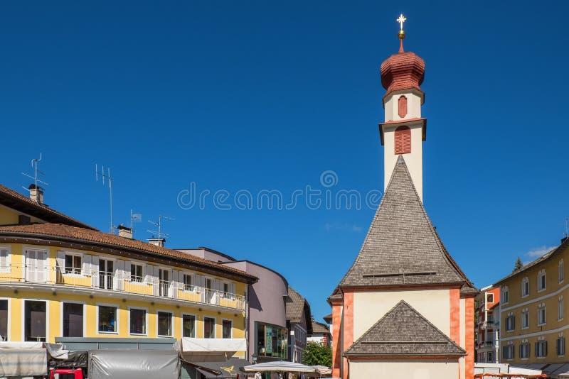 Church and houses in Ortisei in Italian Alps. Church and houses in Ortisei in the Italian Alps stock photos