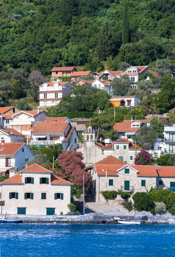 Church and houses with red title roofes. Kamenari is located in Strait of Verige - the narrowest part of Bay of Kotor. royalty free stock photos