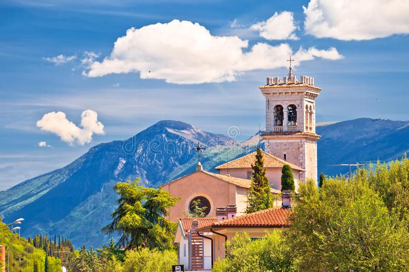 Church on idyllic green hill above Garda lake stock image