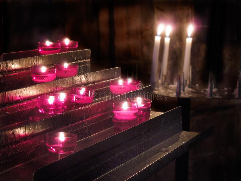 Church Interior Lit Prayer Candles. Fire. Flame. royalty free stock image
