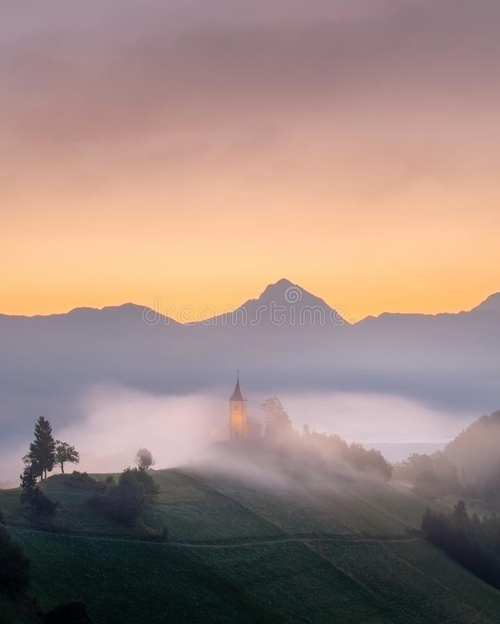 Shot of Kamnik Slovenia. The Church of Kamnik with mountain peaks royalty free stock image