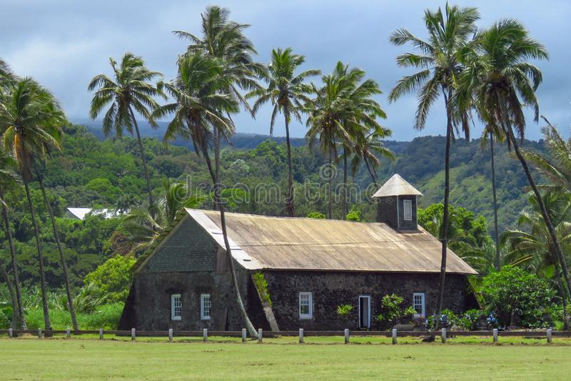 Church at Keanae, road to Hana, Maui, Hawaii. Stone church surrounded by palm trees at Keanae, a traditional Hawaiian village along the Hana Highway, Maui stock photography