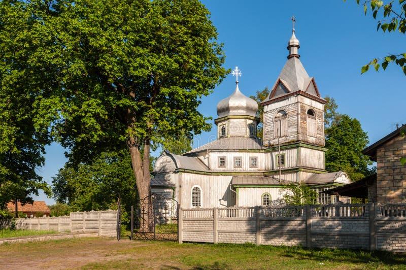 Church of Kosmi and Damian in the village of Kolenci of the Ivankiv district, Ukraine. Kolenci, Kyiv Region, Ukraine - May 11, 2013: Wooden orthodox church of stock images