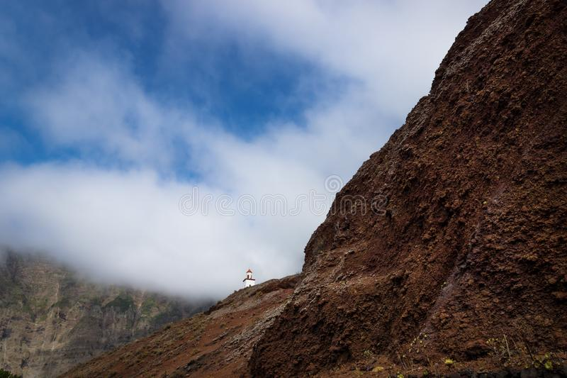 The church La Candelaria on a steep red hill, Frontera, El Golfo, El Hierro, Canary Islands, Spain royalty free stock images