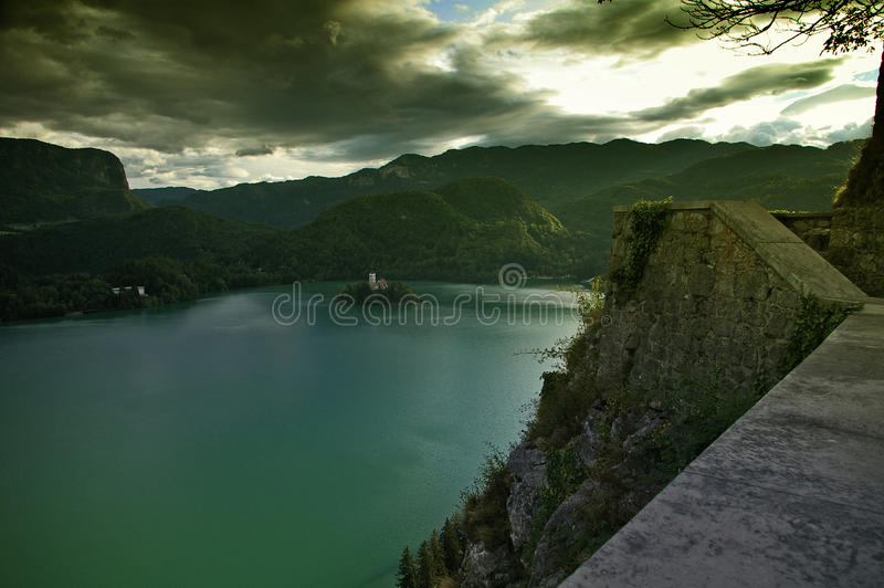 Church on Lake Bled from Castle rampart. The Assumption of Mary Church on Lake Bled in Slovenia viewed from Bled Castle rampart as the sun sets royalty free stock photos