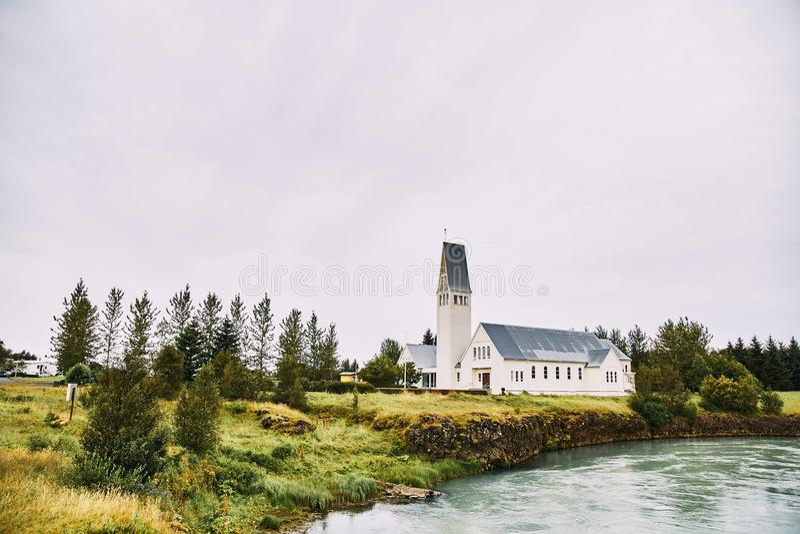 Church on the lake. Iceland stock photo