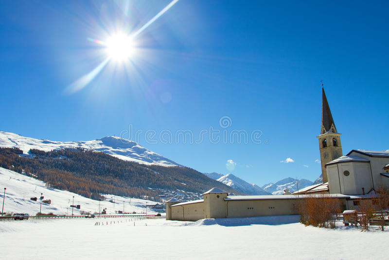 Church in Livigno. Landscape of Livigno in winter, Sondrio, Italy royalty free stock photo