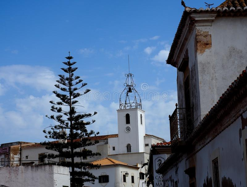 Church In Loule Portugal. With wrought iron bell tower against a blue sky stock photo