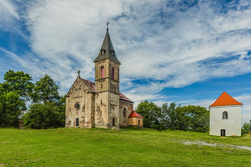Church of the Mary Magdalene. Krasikov, Kokasice / Czech Republic - August 9 2019: View of the church of Mary Magdalene and a bell tower. Bright sunny summer day stock images