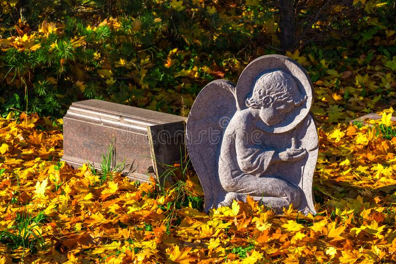 Church monument in the midst of yellow leaves royalty free stock photography