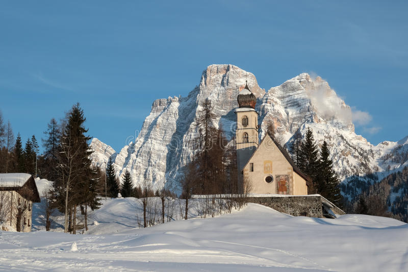 A church between the mountains stock photography