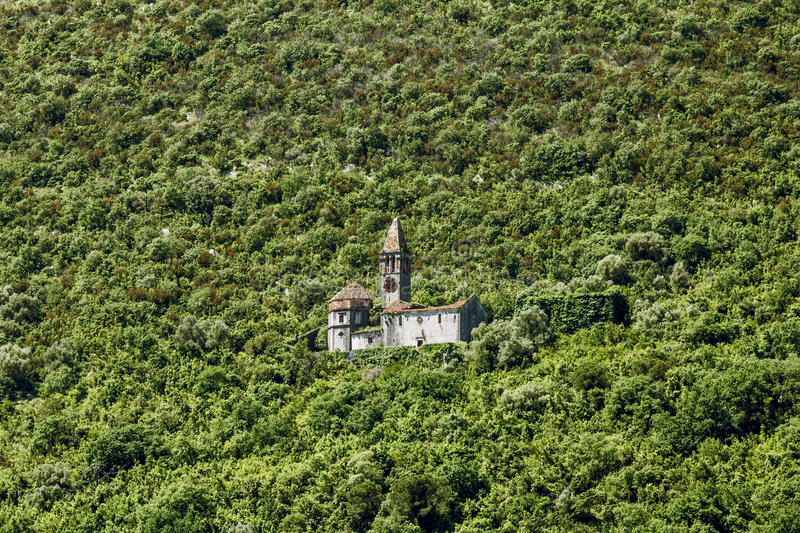 Church in the mountains around the town Prcanj in Kotor bay stock images