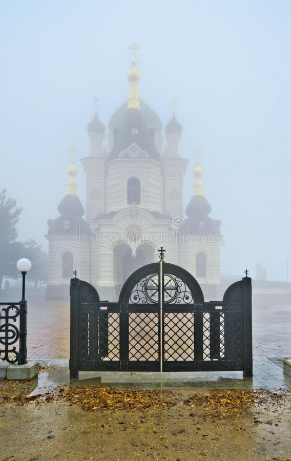 Church in mountains. The Church of Christ's Resurrection within a cloud. It is located on 400-metre Red Cliff over the Black sea near Baidarsky Pass. Crimean stock image