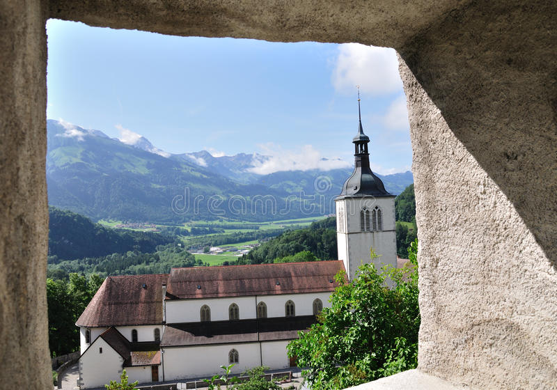 Church near Gruyere castle, Switzerland. View through the window of Gruyere castle, Switzerland, 17.06.11 royalty free stock photos