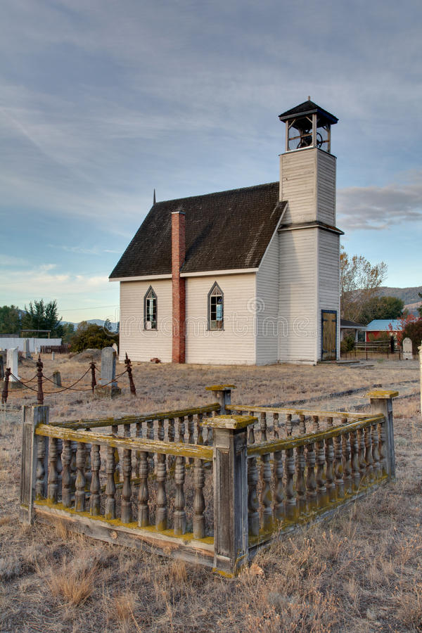 Church in Nicola Valley. Looking past the graveyard of a church in the Nicola Valley near Nicola Lake, British Columbia, Canada. The wooden church was built in stock photos