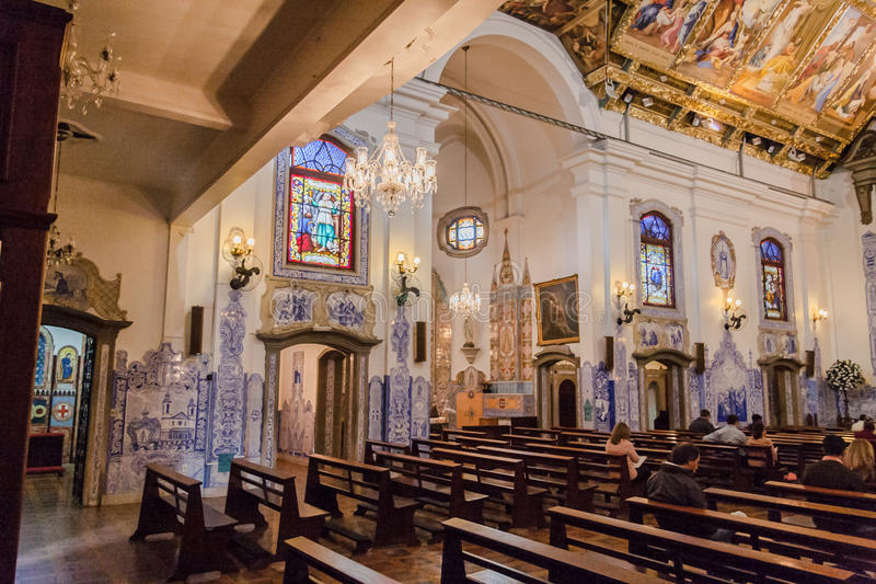 Church Nossa Senhora do Brasil Church Sao Paulo. The main nave of church Nossa Senhora do Brasil with its paintings on its ceiling, wood benches, portuguese blue stock photos