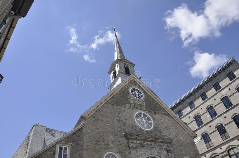 Church Notre Dame des Victoires tower from Place Royale of Old Quebec City in Canada. Ancient Church Notre Dame des Victoires from Place Royale of Old Quebec royalty free stock photos