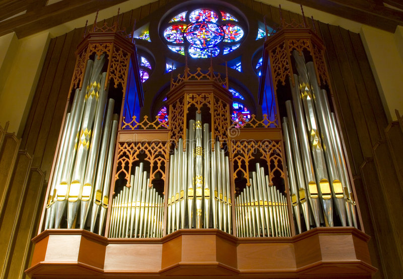 Church Organ. The intricate case and pipework of a beautiful church organ royalty free stock images