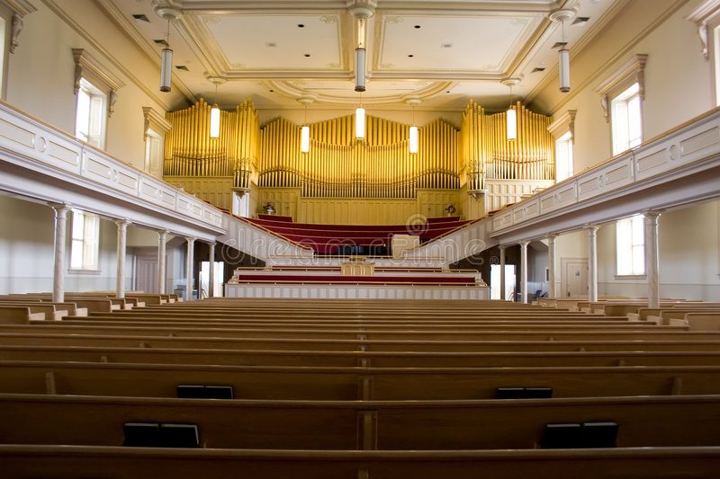 Church with organ. Fancy church assembly hall with old pipe organ royalty free stock image