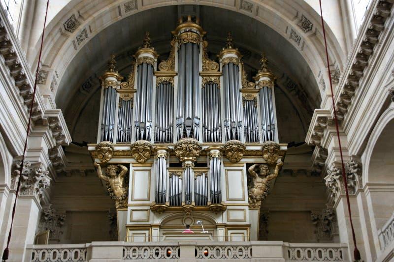 Church organ. Interior of Church of St-Louis-des-Invalides or Soldiers' Church in Paris, France. Beautiful old organ stock photos