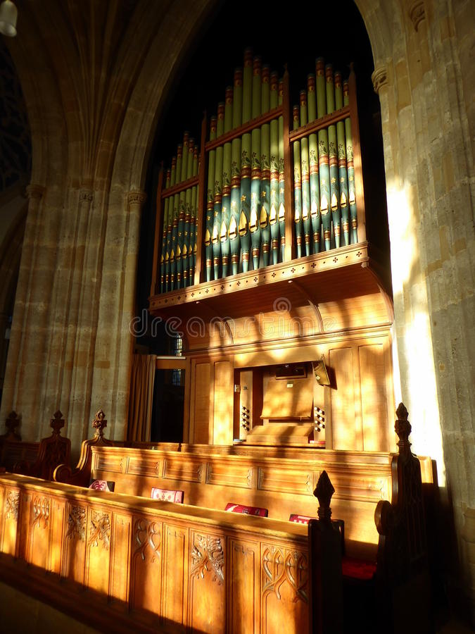 Church organ and choir stalls. The organ and choir stalls in the church of Saint John the Baptist in Axbridge in Somerset, England royalty free stock photo