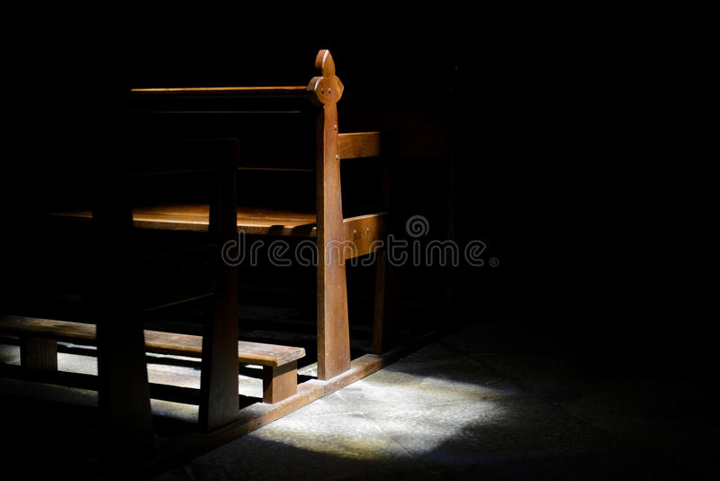 Church pew. Detail of church pew with window light stock photo