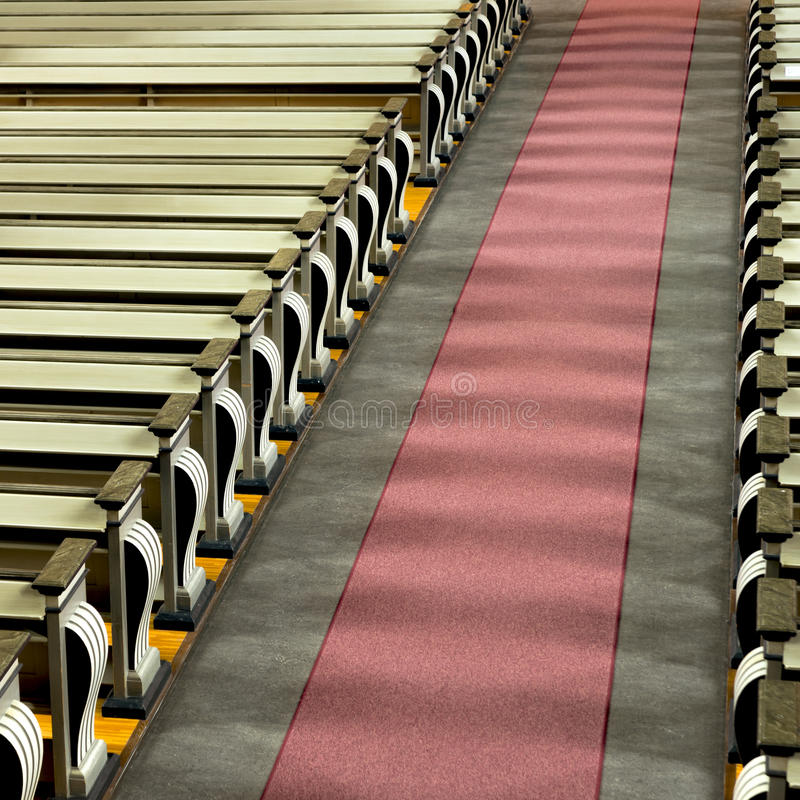 Church pews and aisle in sunshine stock photography