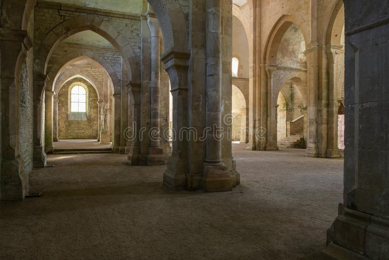 Church Pillars of Abbey Fontenay. Fontenay, France - July 31, 2018: Church with pillars of the romanesque, Cisterian abbey and church, Cote-d`Or, France royalty free stock photos