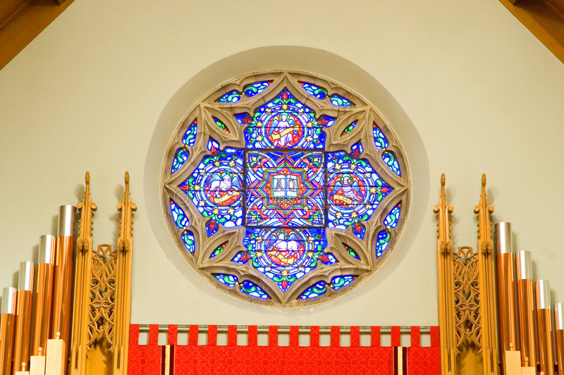 Church pipe organ and window royalty free stock image