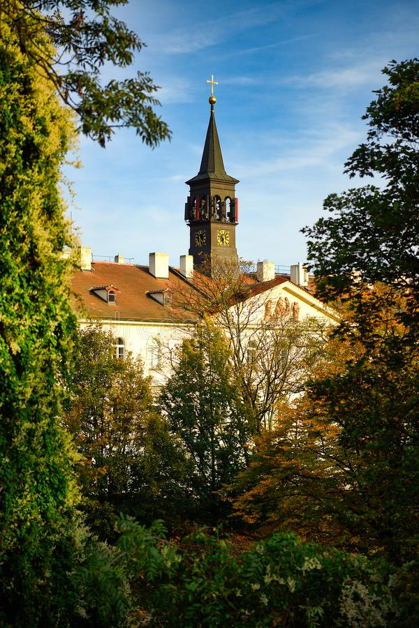 Church in Prague, Praha, Czech Republic. The foreground is a tree changing color. In autumn stock images