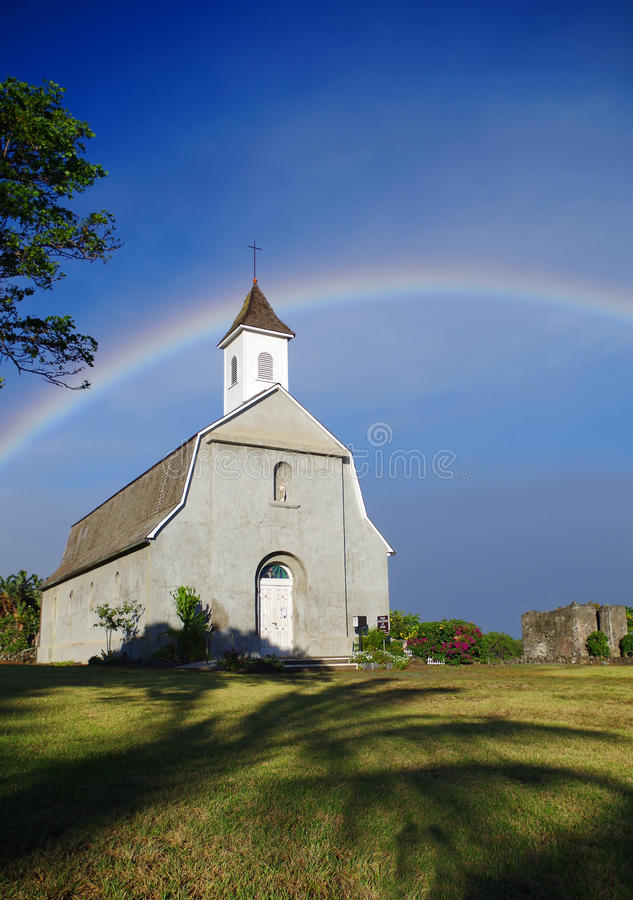 Church and Rainbow near Kaupo in Maui, Hawaii. Nice, colorful rainbow shines in the sunset light above old church near Kaupo, Maui, Hawaii. Space in image for stock photos