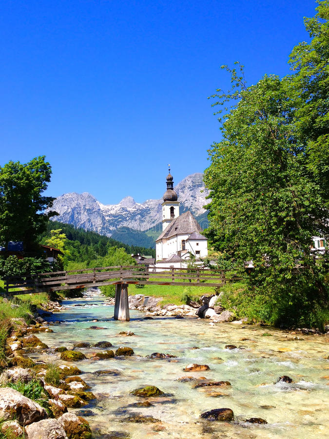 Church in Ramsau, Bavaria. Church, Creek and Mountains in Ramsau, Bavaria stock images