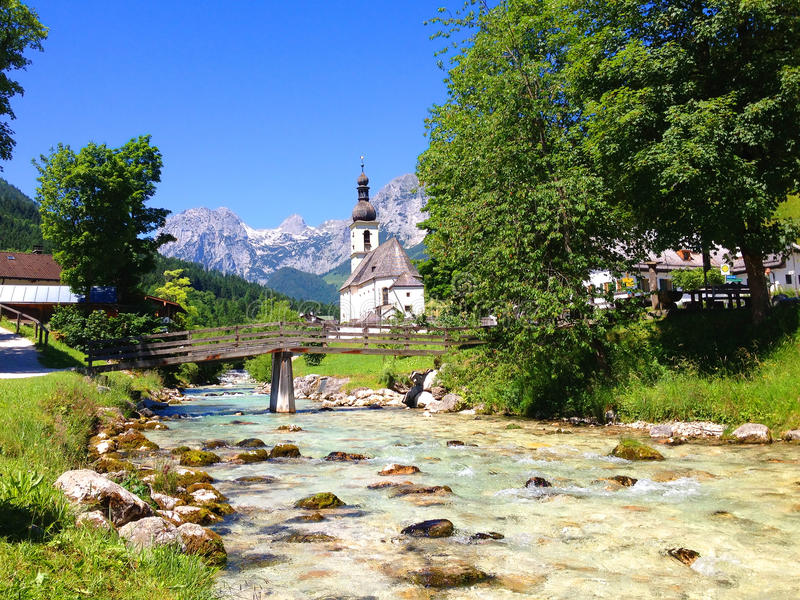 Church in Ramsau, Bavaria. Church, Creek and Mountains in Ramsau, Bavaria royalty free stock photography