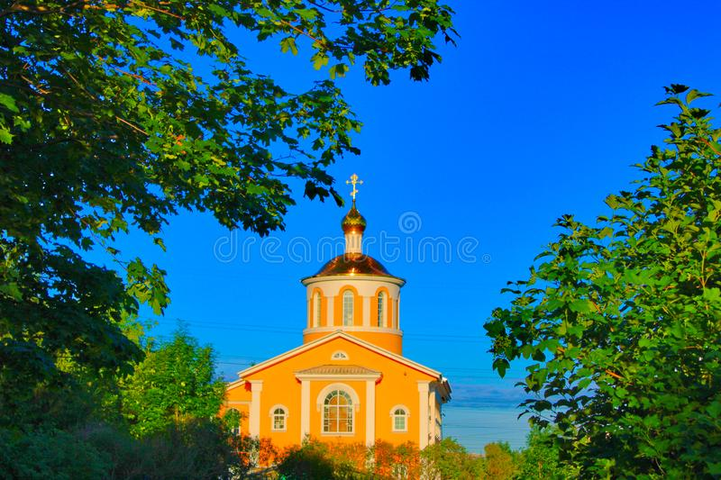 Church in the rays of the rising morning sun stock image