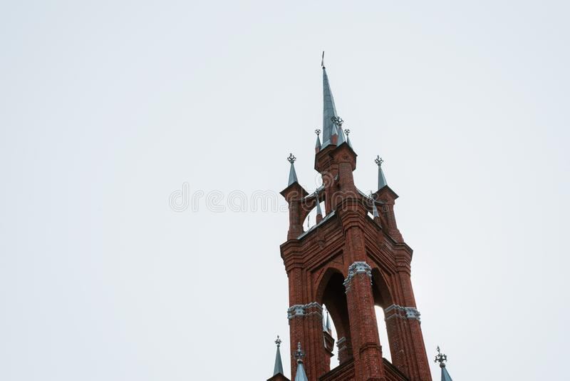 The church is of red brick, with crosses and thin windows stock image