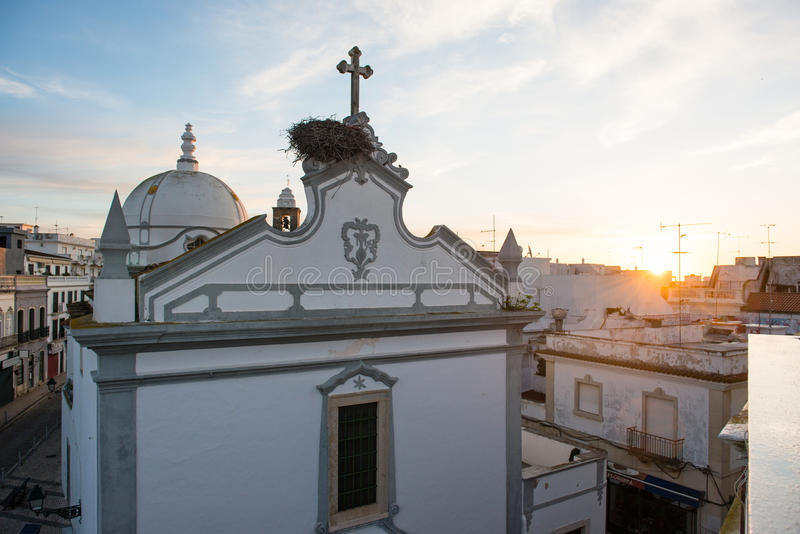 Church and roofs of houses in Olhao, Portugal. During sunrise royalty free stock photo