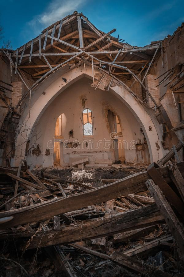 Church in ruins. In which the light enters over the altar and falls right in the center of the temple, illuminating a twig, which is the only thing left royalty free stock photography