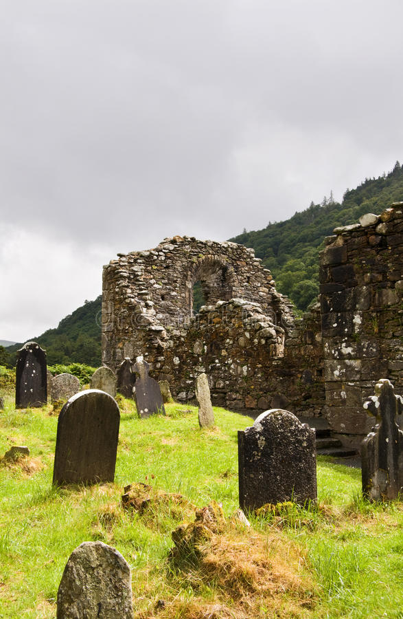 Church ruins at Glendalough. Cathedral ruins at Glendalough (Gleann Da Loch) National Heritage Center in Ireland. View over the ancient cemetery and Wicklow royalty free stock image