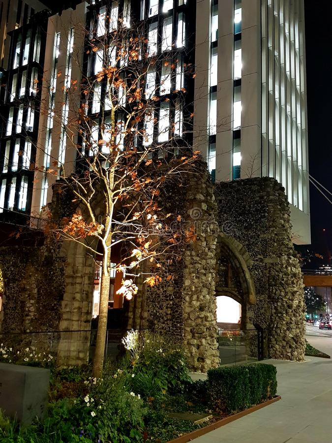 Church ruins and lit up tree. A long London Wall there is this old church remains and I liked the way the tree was lit up royalty free stock photography