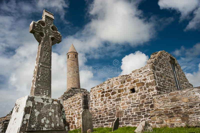 Church ruins and medieval round tower. In county Kerry stock image