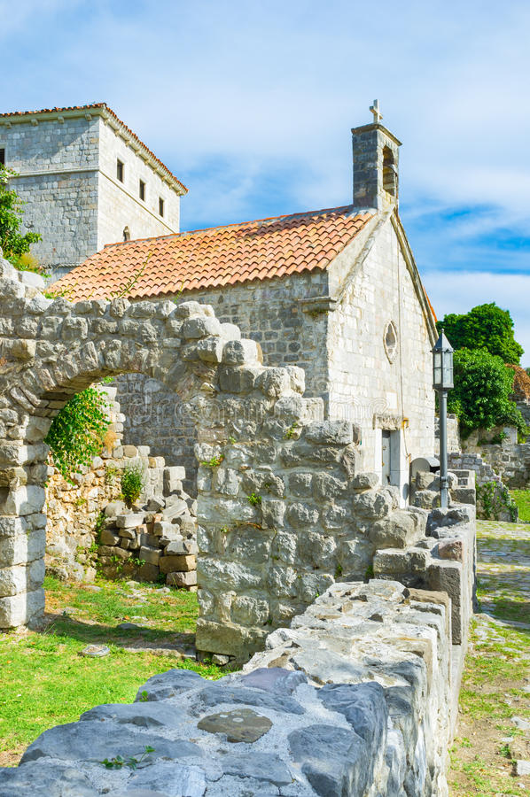 The church among the ruins. The tiny orthodox church in the ruined fortress of Stari Bar still serves, Montenegro stock image