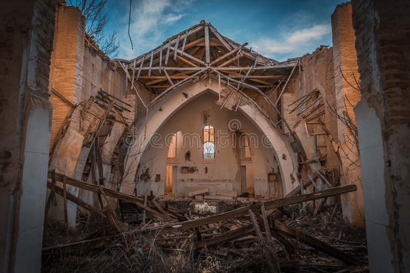 Church in ruins. In which the light enters over the altar and falls right in the center of the temple, illuminating a twig, which is the only thing left royalty free stock image