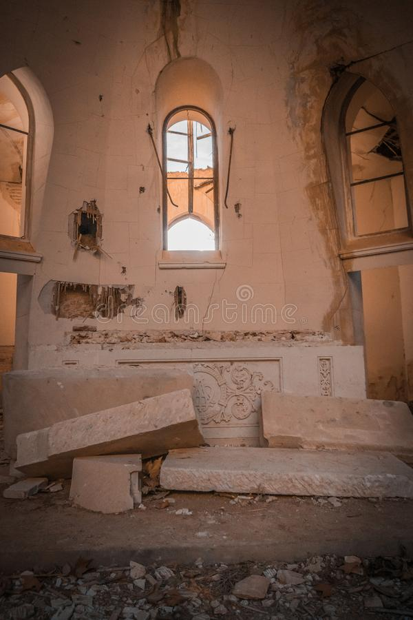 Church in ruins. In which the light enters over the altar and falls right in the center of the temple, illuminating a twig, which is the only thing left stock photos