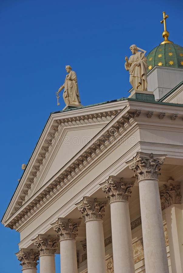 Close up architecture of Helsinki Cathedral top facade with green dome and statue royalty free stock images