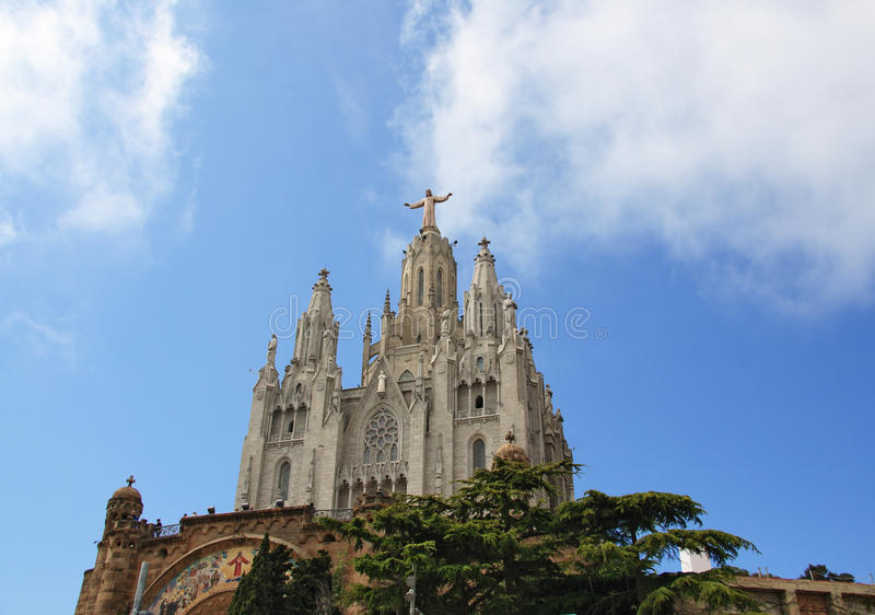Church of the Sacred Heart of Jesus on Mount Tibidabo. Jesus Christus Statue (by Josep Miret) at Expiatory Church of the Sacred Heart of Jesus on summit of Mount royalty free stock photo