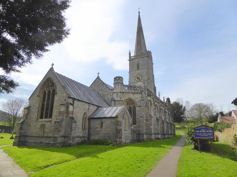 Church with steeple and churchyard. The church of Saint Mary the Virgin and churchyard in the village of East Brent in Somerset, England royalty free stock image