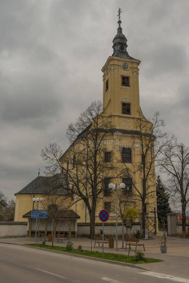 Church of Saint Peter and Paul in Pruske village in spring cold day. Church of Saint Peter and Paul in Pruske village in spring cold grey day, beautiful, cloud stock images