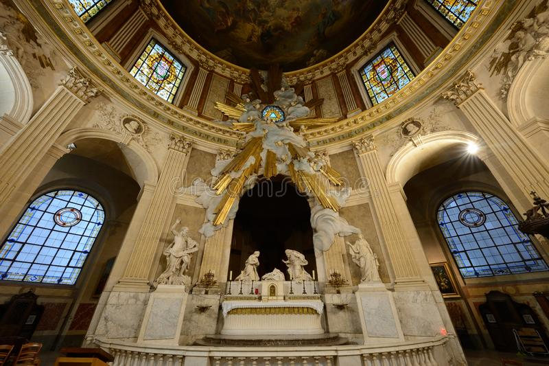The church Saint-Roch in Paris. Near the Tuileries garden, you find the church Saint-Roch with marvelous barocco style stock photography