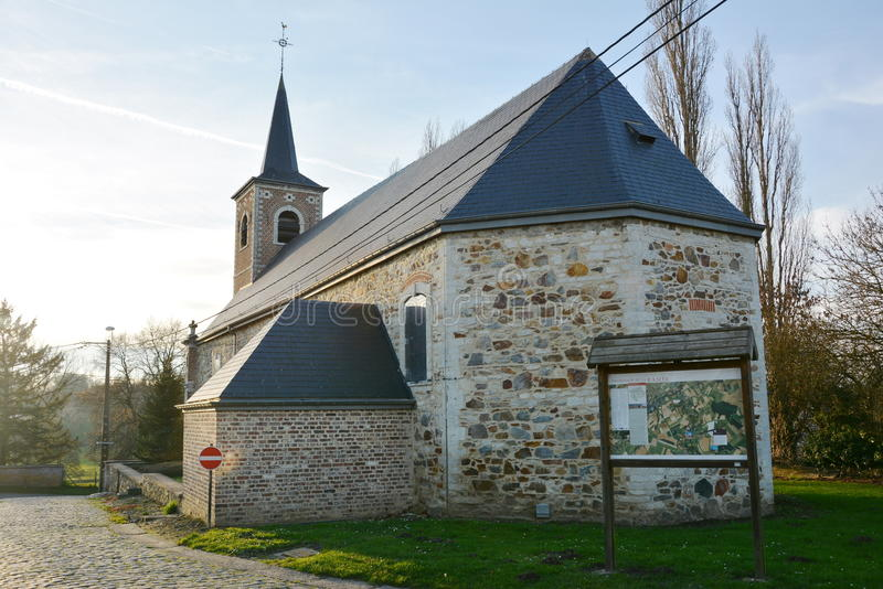 Church of Sainte-Gertrude in Jauchelette-Jodoigne. Church of Sainte-Gertrude in Jauchelette, part of Jodoigne, Belgium, built with typical stones of the region stock photography